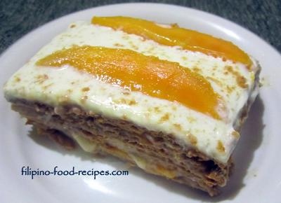 Filipino desserts mango slices in layers of graham crackers and whipped creamrecipe by ariel j forumfinder Images